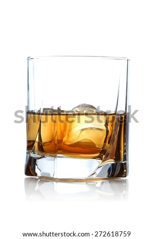 Close-up of glass with whisky - stock photo