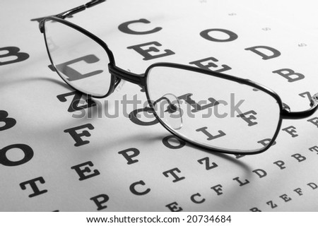close up of glasses and chart - stock photo