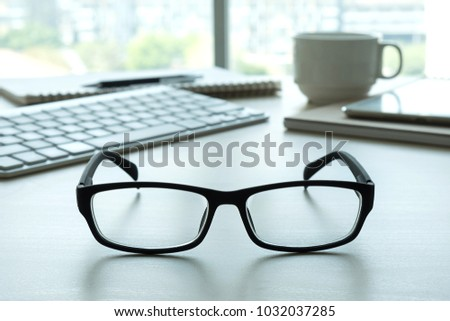 Close up of glasses and computer  business workplace work place in office