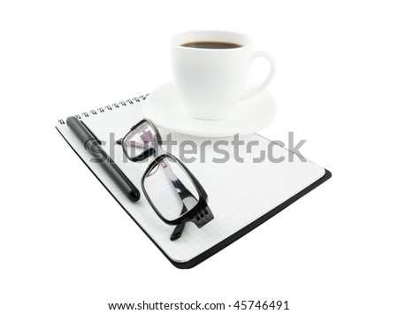 Close-up of glasses, note pad, pen, cup of coffee isolated - stock photo
