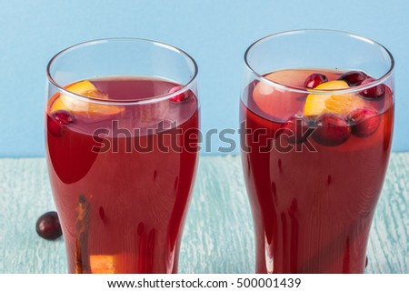 Close up of  glasses with homemade cranberry apple cider.