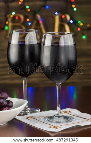 Close up of glasses with red wine on a bar table.