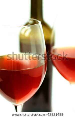 Close up of glasses with red wine on white - stock photo