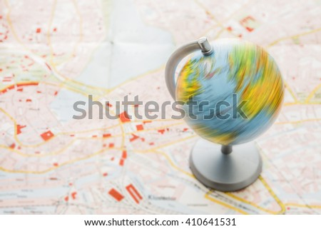 close up of globe with clipping path on urban map background. Empty copy space for inscription or other objects.  - stock photo