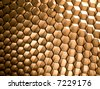 Close-up of glowing honey comb as abstract background. Shallow DOF. - stock photo