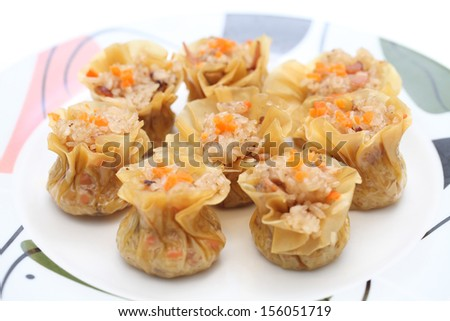 Close up of glutinous rice dumplings on plate. - stock photo