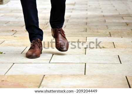 close up of going legs on path - stock photo