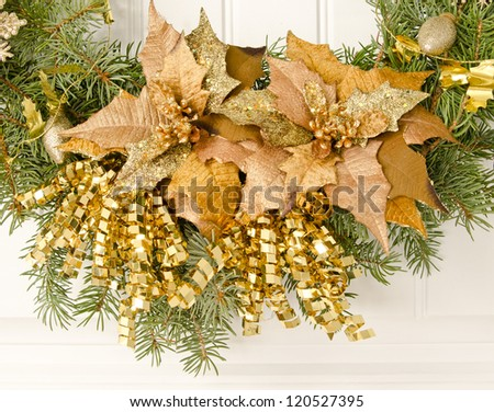 Close up of gold accents on a Christmas wreath - stock photo