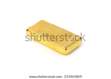 Close up of gold bar isolated on white background - stock photo