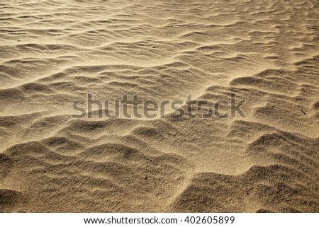 close up of golden and rippled sand - stock photo