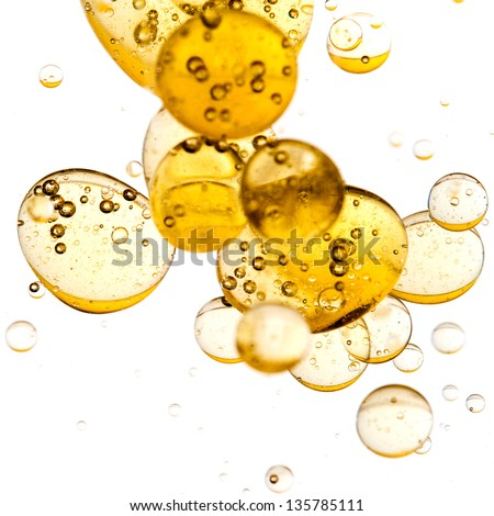 Close up of golden bubbles on illuminated background - stock photo
