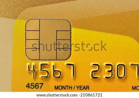 Close up of golden credit card with new chip - stock photo