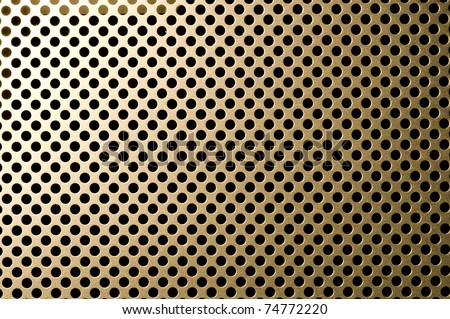 close up of golden grille surface
