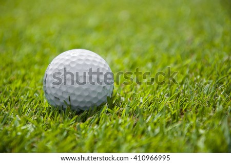 Close up of golf ball in golf course in Alps - stock photo