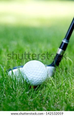 Close-up of golf ball on grass - stock photo