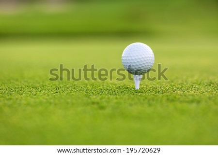 Close up of golf ball on tee - stock photo