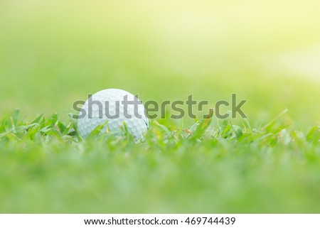 Close up of golf ball on tee,
