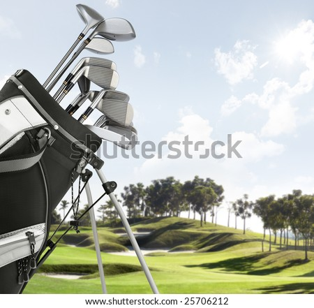 close up of golf equipment, course as background - stock photo