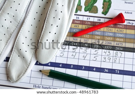 Close up of Golf Score Card with Glove, Pencil, & Tee - stock photo