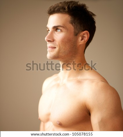 Close up of good looking male looking on his right - stock photo