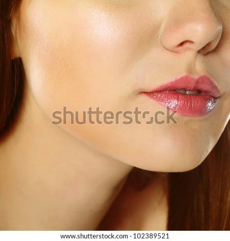 Close-up of gorgeous woman with natural makeup - stock photo
