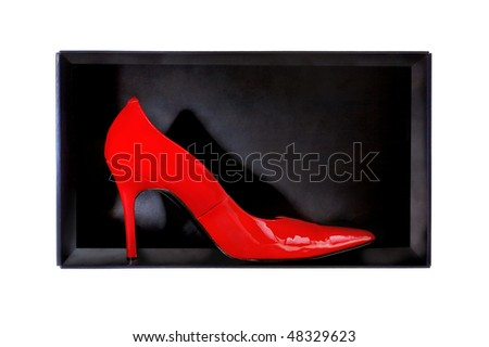 Close-up of graceful female red footwear in a black packing box on a white background - stock photo