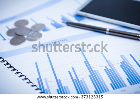 Close-up of graphs and charts analyzed - stock photo