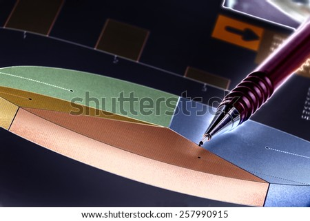 Close up of graphs and paper statements for finance concept - stock photo