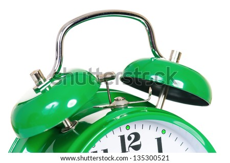 Close-up of green alarm clock on white background