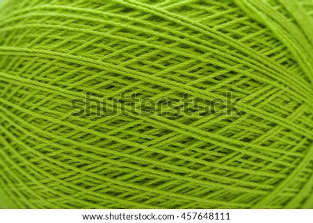 Close up of green ball of wool yarn and knitting needles. Handcraft equipment used for needlework as a hobby. - stock photo