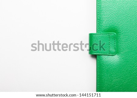 Close up of green leather cover of notebook