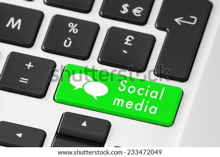 Close up of green social media button on keyboard with speech bubbles - stock photo
