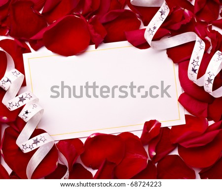 close up of greeting card with rose petals decoration - stock photo