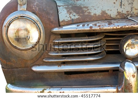 Close up of grille of rusty vintage car - stock photo