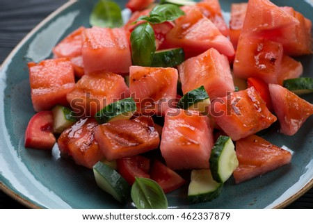 Close-up of grilled watermelon, tomato and cucumber salad, selective focus