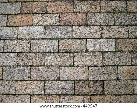 Close-up of ground with rectangular paving stones - stock photo