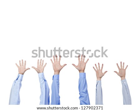 Close up of group of hands raised on a white background - stock photo