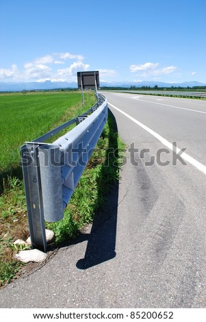 Close up of guard rail on a road in countryside - stock photo