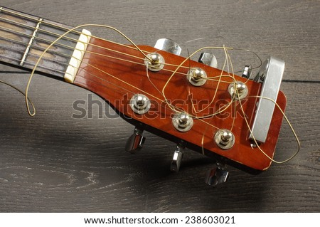 Close up of guitar head with tuning pegheads - stock photo