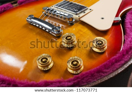 close-up of guitar knobs - stock photo