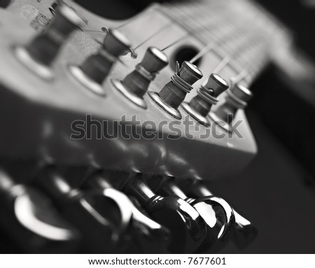 Close up of guitar machine head in black and white