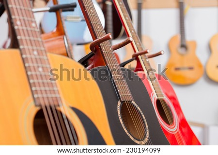 Close-up of guitars in a music shop. selective focus