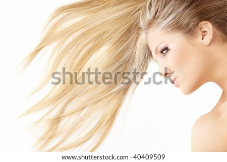 Close up of hair and face of beautiful lying blonde, isolated - stock photo