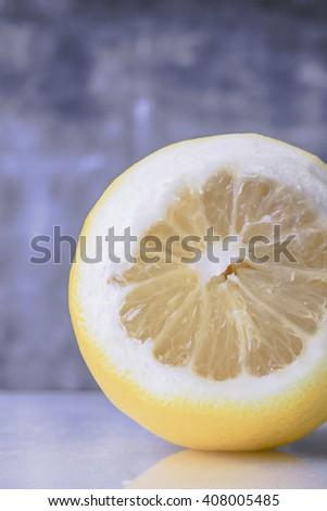 Close up of half a lemon. - stock photo