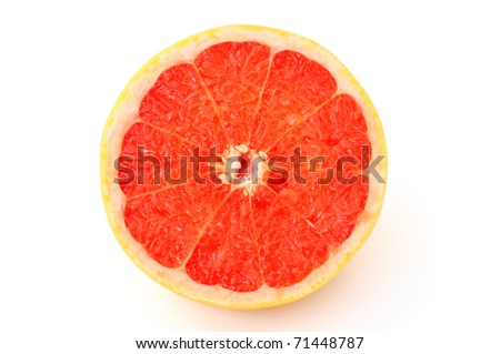 close-up of half grapefruit on white background - stock photo