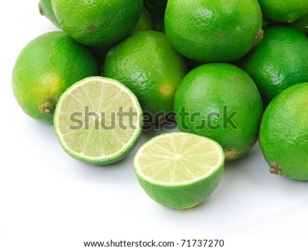 close-up of half lime with wole limes - stock photo
