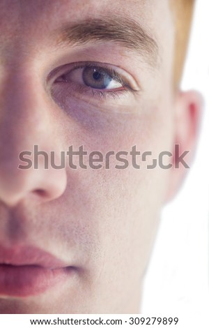 Close up of half the face of a man - stock photo