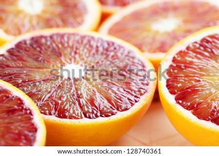 Close up of halved blood orange. Shallow dof - stock photo