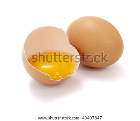 close up of halved broken egg on white background, with clipping path - stock photo