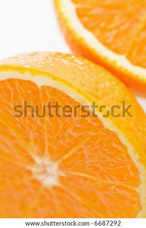 Close up of halved orange against white background.